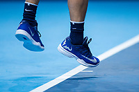 The Nike trainers of Rafael Nadal of Spain (1) as he serves against David Goffin of Belgium (7) during their Pete Sampras group match - Goffin def Nadal 7-6, 6-7, 6-4<br /> <br /> Photographer Craig Mercer/CameraSport<br /> <br /> International Tennis - Nitto ATP World Tour Finals - O2 Arena - London - Day 2  - Monday 13th November 2017<br /> <br /> World Copyright &copy; 2017 CameraSport. All rights reserved. 43 Linden Ave. Countesthorpe. Leicester. England. LE8 5PG - Tel: +44 (0) 116 277 4147 - admin@camerasport.com - www.camerasport.com