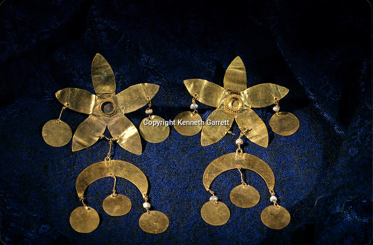 Gold artifacts from Tillya Tepe find,  six tombs of Bactrian nomads; Discovered in 1978 by Soviet archaeologist; Thought lost but discovered in 2003 in Afghan National Bank Vault, at the Presidential Palace; saved from the  Mujahadein and Taliban; Elements of  Greek, Indian, Asian culture.