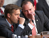 United States Senators Ben Masse (Republican of Nebraska), left, and Mike Lee (Republican of Utah), right, converse as Judge Brett Kavanaugh testifies before the US Senate Judiciary Committee on his nomination as Associate Justice of the US Supreme Court to replace the retiring Justice Anthony Kennedy on Capitol Hill in Washington, DC on Thursday, September 6, 2018.<br /> Credit: Ron Sachs / CNP<br /> (RESTRICTION: NO New York or New Jersey Newspapers or newspapers within a 75 mile radius of New York City)