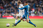 Luka Modric (l) of Real Madrid fights for the ball with Theo Bongonda Mbul'ofeko Batombo of RC Celta de Vigo during their Copa del Rey 2016-17 Quarter-final match between Real Madrid and Celta de Vigo at the Santiago Bernabéu Stadium on 18 January 2017 in Madrid, Spain. Photo by Diego Gonzalez Souto / Power Sport Images