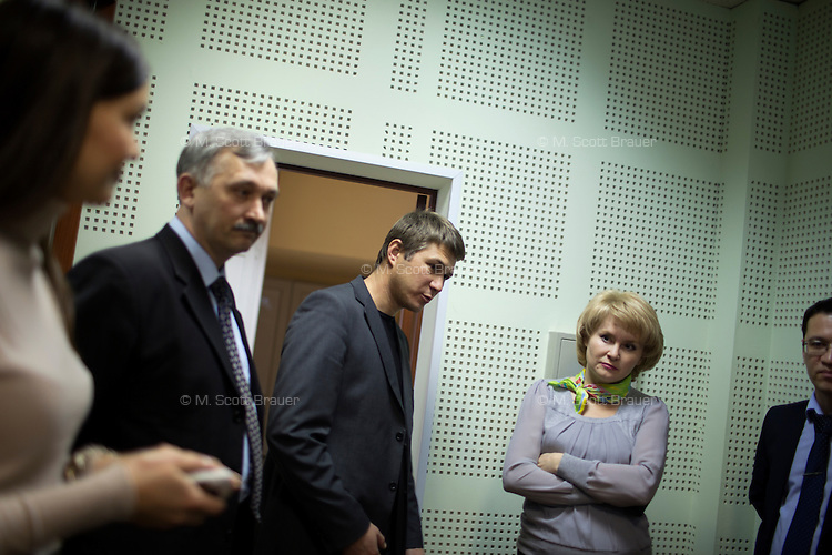 News editors and radio producers talk in an office in the Telecenter radio and television studio in Ufa, Bashkortostan, Russia.