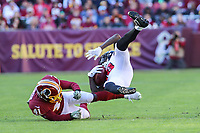 Landover, MD - November 4, 2018: Washington Redskins defensive back Danny Johnson (41) tackles Atlanta Falcons wide receiver Calvin Ridley (18) during the  game between Atlanta Falcons and Washington Redskins at FedEx Field in Landover, MD.   (Photo by Elliott Brown/Media Images International)