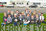 &nbsp;SUNSHINE: Doing their lessons on their first day in the sunshine at St Brendan's National School, Fenit, on Monday. Front l-r: Dara Heim, Edward Stack, Michael Dolan, Caoimhín Finn, Darragh O'Sullivan and Conor Gaynor. Back l-r: Shannon Brown, Liana Williams, Ellen Moriarty, Tara O'Connor, Jane Doyle, Allie Parker, Caoimhe Doyle, Conor Lenihan, Sean Vieux, Ciaran Tuite and Niall Cassidy.<br />