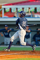 Ruben Contreras #21 of the Princeton Rays follows through on his swing against the Burlington Royals at Burlington Athletic Stadium July 11, 2010, in Burlington, North Carolina.  Photo by Brian Westerholt / Four Seam Images
