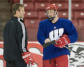 Jack Skille chats with Assistant Coach Mark Osiecki during the October 28 morning skate.  This was Skille's first practice with a bladed stick since he dislocated his elbow against North Dakota on October 13.  Unfortunately for me, while the students dressed for Halloween on both Friday (10/27) and Saturday (10/28) nights, the coaches waited the actual Halloween practice to play dress-up.  Osiecki skated out onto the ice in full Gene Simmons KISS getup from the hair to the makeup to shiny dangles on his skate boots.