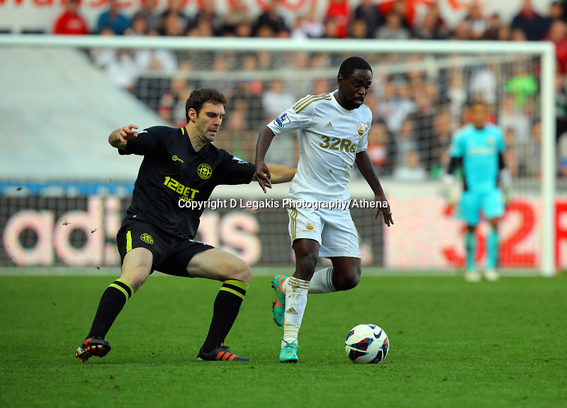 Saturday, 20 October 2012<br /> Pictured: Nathan Dyer of Swansea (R) marked by a Wigan player<br /> Re: Barclays Premier League, Swansea City FC v Wigan Athletic at the Liberty Stadium, south Wales.