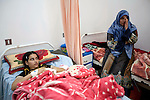 Mcc0030300 . Sunday Telegraph..13 yr old Hanin Mohamed with her aunt Huda Abd-Ilfattah in one of the main hospitals in Benghazi.. Hanin was seriously wounded in the leg by shrapnel from a Libyan government shell in the beseiged town of Ajdabiyah, 150 kms from Benghazi...Benghazi 25 March 2011