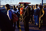 Commuters in Khayelitsha wait for a train to take them to work in Cape Town, South Africa. (Photo by: Per-Anders Pettersson)