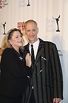 Kathleen Turner & John Waters attend The 63rd Annual Writers Guild Awards on Sarturday, February 5, 2011 at the AXA Equitable Center, New York City, New York. (Photo by Sue Coflin/Max Photos)