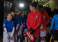 COLUMBUS, OH - NOVEMBER 07: Carli Lloyd #10 of the United States talks to a player escort during a game between Sweden and USWNT at Mapfre Stadium on November 07, 2019 in Columbus, Ohio.