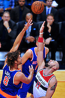 Robin Lopez of the Knicks shoots over Marcin Gortat of the Wizards. New York defeated Washington 115-104 during a NBA preseason game at the Verizon Center in Washington, D.C. on Friday, October 9, 2015.  Alan P. Santos/DC Sports Box