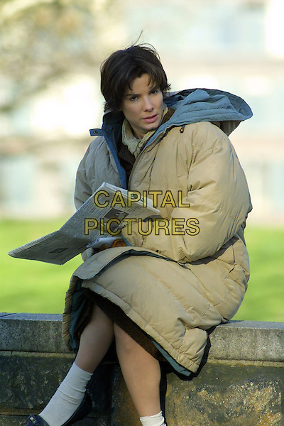 "SANDRA BULLOCK.On the set of ""Every Word I Say Is True""..Fort Greene Park, Brooklyn, New York..April 12th, 2005.Ref: IW.half length  short hair winter jacket coat ankle socks newspaper.www.capitalpictures.com.sales@capitalpictures.com.©Ian Wilson/Capital Pictures."