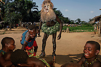 The whipping is more severe on the last day and includes a ceremony where the boys are secluded within a phalanx of men all carrying whips... the men are met halfway thru the village with women carrying whips and a melee ensues trying to control the destiny of the child... the men win... the boy is now a man and cannot be claimed as a child anymore by his mother.  There is also ritual scarification on this day and each boy is paraded, one by one thru the village accompanied by a masked elder and someone to collect the money being thrown at his dancing feet...