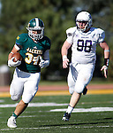 SPEARFISH, S.D. -- OCTOBER 1, 2016: Phydell Paris #34 of Black Hills State runs for a gain while pursued by Matthew Neale #98 of New Mexico Highlands during their game Saturday at Lyle Hare Stadium in Spearfish, S.D.  (Photo by Dick Carlson/Inertia)