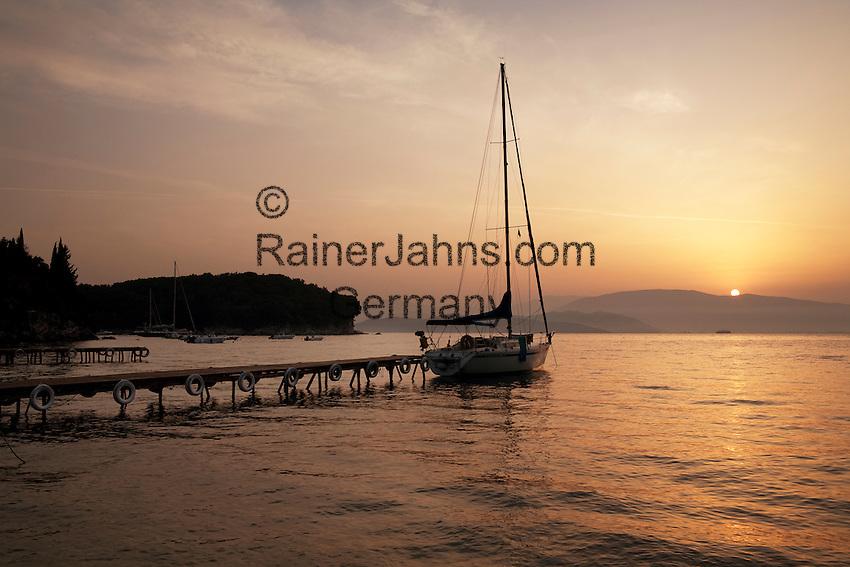 Greece, Corfu, Agni: Sunrise over pier and yacht