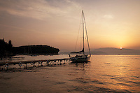 Greece, Corfu, Agni: Sunrise over pier and yacht