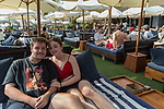 6 DECEMBER, 2019 BALI, INDONESIA: Paul Strickland and Bethany Longden, both 17 from Perth, relax at The Lawn beach club in Canggu, Bali. There has been a levelling out of Australian tourist numbers to Bali in recent times and tastes are changing regarding what people want from their holiday. Millennials are being targeted by tourism authorities and they want to give them more boutique experiences than just beach and beer. Picture by Graham Crouch/The Australian