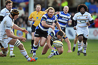 Ross Batty of Bath Rugby barges past team-mate Sam Burgess to get to the ball. Aviva Premiership match, between Bath Rugby and Wasps on January 10, 2015 at the Recreation Ground in Bath, England. Photo by: Patrick Khachfe / Onside Images
