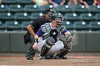 Winston-Salem Dash catcher Zack Collins (30) catches a pitch as home plate umpire Zach Tieche looks on during the game against the Potomac Nationals at BB&T Ballpark on July 15, 2016 in Winston-Salem, North Carolina.  (Brian Westerholt/Four Seam Images)