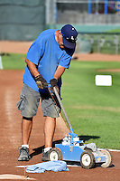 Ogden Raptors ground crew paints the field prior to the game against the Missoula Osprey in Pioneer League action at Lindquist Field on August 4, 2014 in Ogden, Utah.  (Stephen Smith/Four Seam Images)