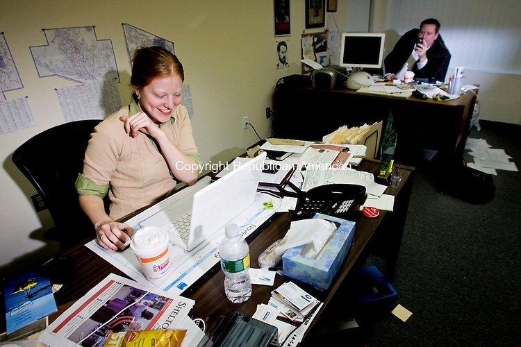 ANSONIA, CT - 25 NOVEMBER 2009 -112509JT04--<br /> Reporter Jodie Mozdzer laughs as editor Eugene Driscoll records video with the hand-held camera he also uses to cover stories for the Valley Independent Sentinel, a new online news web site that covers towns in the Naugatuck Valley, on Wednesday at the Sentinel's Ansonia office.<br /> Josalee Thrift Republican-American