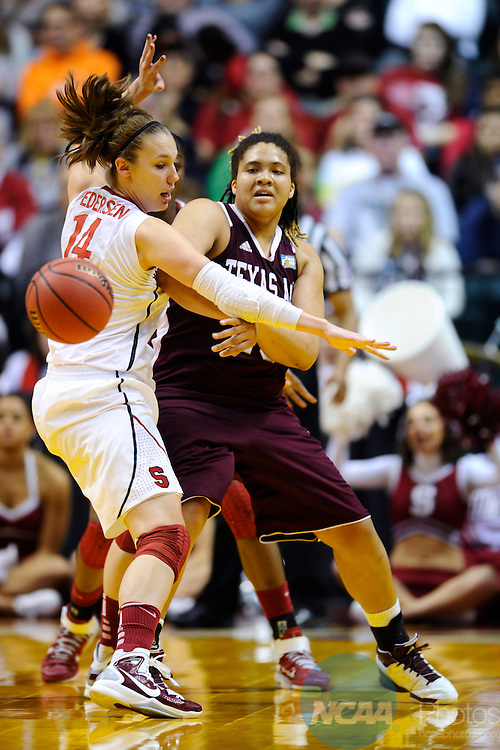 03 APR 2011:  Texas A&M forward Danielle Adams (23) passes the ball around Stanford University's Kayla Pedersen (14) during the Division I Women's Basketball Semifinals held at Conseco Fieldhouse in Indianapolis, IN.  Texas A&M defeated Stanford by a score of 63-62 to advance to the National Championship game.  Stephen Nowland/NCAA Photos