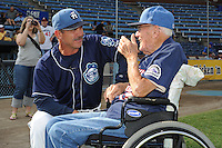 Asheville Tourists manager Joe Mikulik #20 discusses baseball with former Tourists manager Ray Hathaway on Ray Hathaway night before a game against the Rome Braves at McCormick Field on August 20, 2011 in Asheville, North Carolina. Rome won the game 10-9.   (Tony Farlow/Four Seam Images)