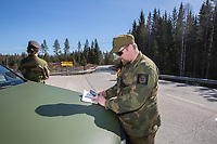 Home Guard soldier Thore Rinden making notes.  Norwegian authorites introduced strict measures to combat the Coronavirus (COVID-19) in March 2020. This included closing the borders, and any Norwegians returning from abroad is given two weeks quarantine. <br /> <br /> Police and soldiers from the Home Guard of the Army (Heimevernet) man checkpoints along side roads and regular border crossings to enforce the travel restrictions.<br /> <br /> <br /> <br /> ©Fredrik Naumann/Felix Features