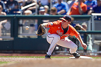 Virginia Cavaliers first baseman Pavin Smith (10) records a put out against the Florida Gators in Game 11 of the NCAA College World Series on June 19, 2015 at TD Ameritrade Park in Omaha, Nebraska. The Gators defeated Virginia 10-5. (Andrew Woolley/Four Seam Images)