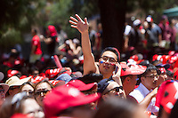 Los Angeles, CA -  Sunday, June 22, 2014: One man ways to his friends as thousands of Koreans watched the South Korea vs. Algeria first round match on the  front lawn of Wilshire Park Place.