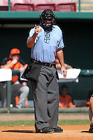 Home plate umpire Matt McCoy makes a calling during a game between the Netherlands National Team and Detroit Tigers at Al Lang Field on March 8, 2012 in St. Petersburg, Florida.  (Mike Janes/Four Seam Images)