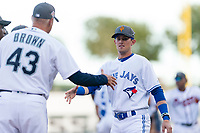 AFL West left fielder Cavan Biggio (26), of the Surprise Saguaros and Toronto Blue Jays organization, prepares to shake hands with manager Daren Brown (43) during player introductions before the Arizona Fall League Fall Stars game at Surprise Stadium on November 3, 2018 in Surprise, Arizona. The AFL West defeated the AFL East 7-6 . (Zachary Lucy/Four Seam Images)