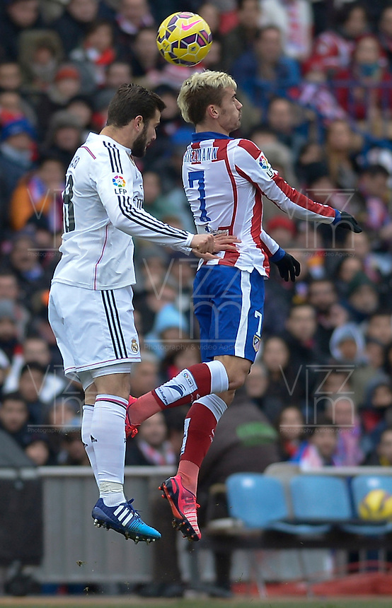 MADRID (SPAIN), FEBRUARY, 7, 2015. Griezmann of Atlético de Madrid fights for the ball with Nacho of Real Madrid during the football match of Atlético de Madrid vs Real Madrid at Vicente Calderón stadium for Spanish Soccer League 2014-2015 . PATRICIO REALPE/ASNERP