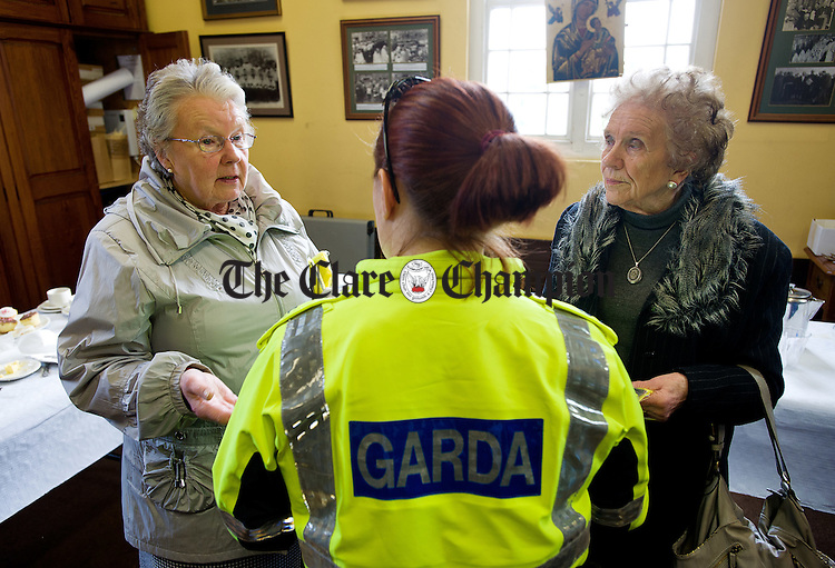 Pat Clohessy and Mai Fogarty chatting with Garda Deirdre Doherty at a coffee morning in Ennis Cathedral, organised by Colaiste Muire Ennis Transition Year Students in conjunction with An Garda Siochana as part of their Positive Ageing YSI project. Photograph by John Kelly.
