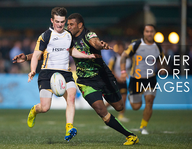HSBC Penguins play ULR Samurai International in the Cup Final on Day 2 of the GFI HKFC Tens 2013 at the Hong Kong Football Club, Hong Kong. Photo by Manuel Queimadelos / The Power of Sport Images
