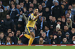 Theo Walcott of Arsenal celebrates the opening goal during the English Premier League match at the Etihad Stadium, Manchester. Picture date: December 18th, 2016. Picture credit should read: Simon Bellis/Sportimage