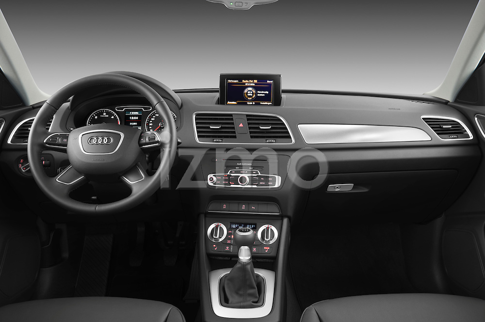 Straight dashboard view of a 2012 Audi Q3 SUV.