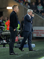 (L-R) Swansea manager Garry Monk and Stoke City manager Mark Hughes keep their cool during the Barclays Premier League match between Swansea City and Stoke City played at the Liberty Stadium, Swansea on October 19th 2015
