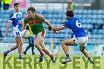 Cormac Coffey Kerins O'Rahillys in action against Kevin McCarthy Kilcummin Senior Football Championship Relegation Playoff in Austin Stack Park on Sunday