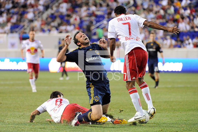 Chris Klein (7) of the Los Angeles Galaxy goes down from a tackle by Sinisa Ubiparipovic (8) of the New York Red Bulls. The Los Angeles Galaxy defeated the New York Red Bulls 1-0 during a Major League Soccer (MLS) match at Red Bull Arena in Harrison, NJ, on August 14, 2010.
