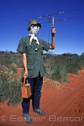 Woman, zoologist from Sydney University with unique protection from bush flies while studying in Simpson Desert, Queensland.