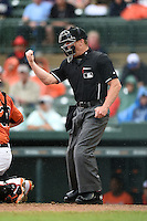 Umpire Toby Basner makes a call during a spring training game between the Boston Red Sox and Baltimore Orioles on March 24, 2014 at McKechnie Field in Bradenton, Florida.  (Mike Janes/Four Seam Images)