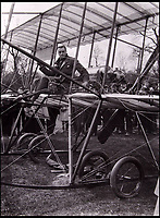 BNPS.co.uk (01202 558833)<br /> Pic: EastBristolAuctions/BNPS<br /> <br /> Claude Grahame-White shortly before his aircraft came to a sticky end...<br /> <br /> Photographs showing the founder of Rolls Royce moments before he became the first person in Britain to be killed in an air crash have been unearthed.<br /> <br /> The remarkable black and white snaps depict a nervous-looking Charles Rolls sat amongst the inner workings of a primitive biplane in 1910.<br /> <br /> Wearing just a cloth cap and scarf for protection, one eye-witness described how a 'look of doom' appeared across Rolls' face before moments before take off.<br /> <br /> A second image shows the aircraft lifting off from the ground just two minutes before its tail snapped off, sending the plane crashing to the ground and killing Rolls instantly.<br /> <br /> The two photos are part of an archive of early aviation photos coming up for sale.