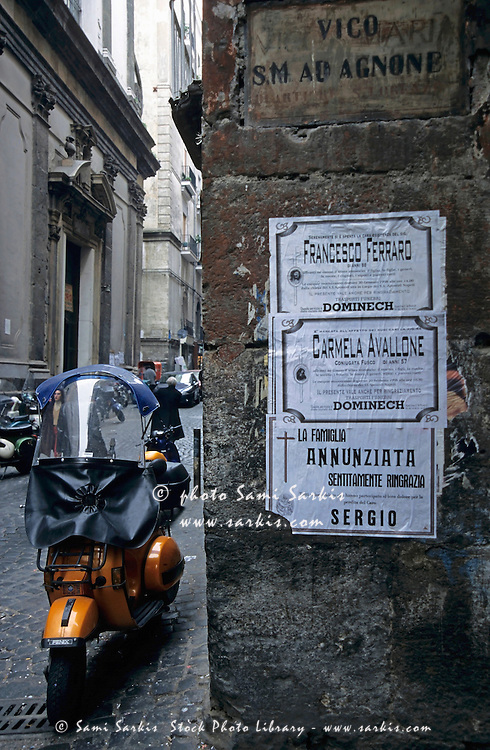 Scooter parked in a small alleyway, Naples, Italy.