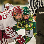24 November 2013: University of Vermont Catamount Forward Matt White, a Senior from McMurray, PA, takes a face-off against University of Massachusetts Minutemen Forward Peter DeAngelo, a Senior from Milford, MA, in second period action at Gutterson Fieldhouse in Burlington, Vermont. The Cats wore special camouflage jerseys to celebrate Military Appreciation Day. The game-worn jerseys were auctioned off with proceeds benefiting the Vermont Veterans Fund (VVF). The Catamounts shut out the Minutemen 2-0 to sweep the 2-game home-and-away weekend Hockey East Series. Mandatory Credit: Ed Wolfstein Photo *** RAW (NEF) Image File Available ***
