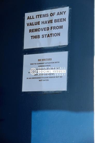 Covid 19 - Coastguard station door with sign, closed due to Coronavirus, St Aldhelm's Head Dorset. UK April 2020