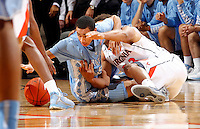 North Carolina guard Marcus Paige (5) gets tangled up with Virginia guard Justin Anderson (23) going after a loose ball during the game at the John Paul Jones arena in Charlottesville, Va. Photo/Andrew Shurtleff