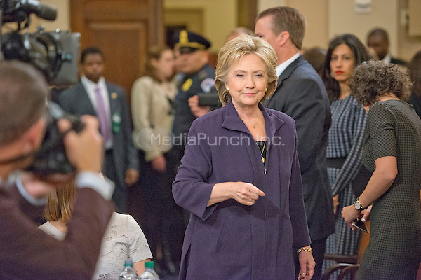 Former United States Secretary of State Hillary Rodham Clinton, a candidate for the 2016 Democratic Party nomination for President of the United States, arrives at the witness table prior to her testimony before the US House Select Committee on Benghazi on Capitol Hill in Washington, DC on Thursday, October 22, 2015.<br /> Credit: Ron Sachs / CNP/MediaPunch