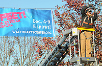 NWA Democrat-Gazette/DAVID GOTTSCHALK Chase Pittman, an installer with Signarama of Johnson, stretches a banner Monday, November 26, 2018, across Dickson Street in Fayetteville. The banner promotes the upcoming On Your Feet! The Emilio & Gloria Estefan Broadway Musical December 4-9 at the Walton Arts Center.