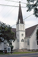 """Carpinteria Valley Baptist Church (L-shaped), 1892; originally, First Methodist of Santa Maria. """"A delightful small Gothic Revival church with excellent Eastlake leaded stained windows."""" Photo '85."""